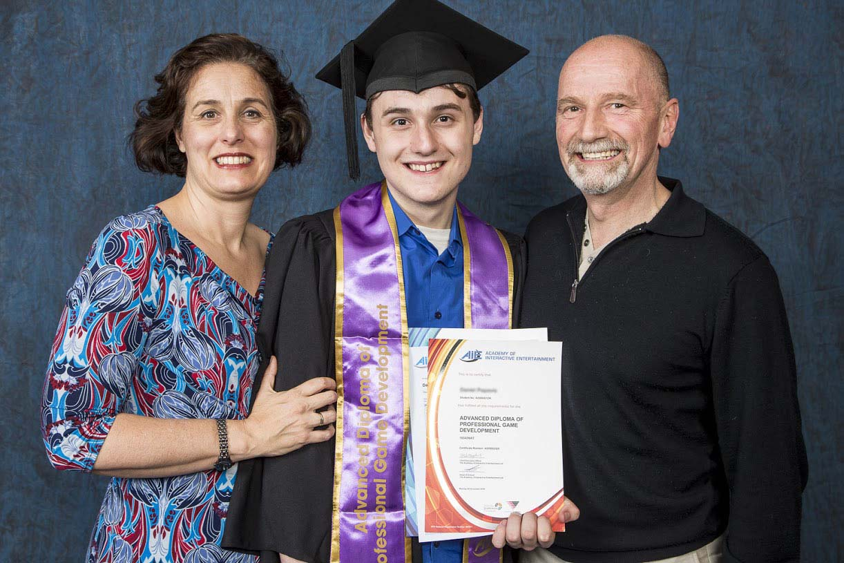 Mother and father with graduate