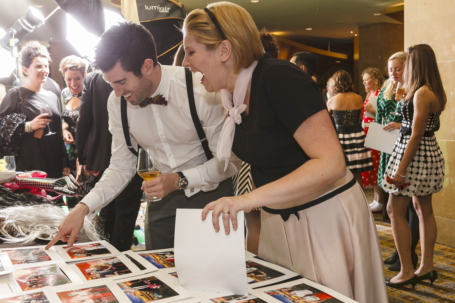 Couple looking at photos at event